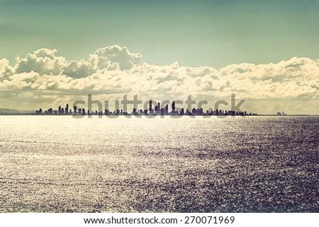Gold Coast city skyline at sunset,Vintage effect - stock photo