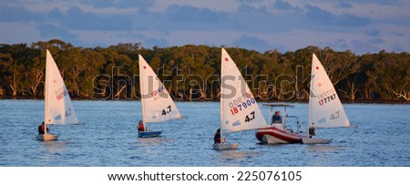 GOLD COAST - OCT 16 2014:Australian youth learns to sail. With 9 times more waterways than Venice, the Gold Coast is a boating paradise with over 260 kilometers of navigable waterways within the city. - stock photo