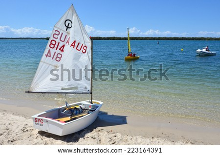 GOLD COAST - SEP 30 2014:Australian youth learns to sail. With 9 times more waterways than Venice, the Gold Coast is a boating paradise with over 260 kilometers of navigable waterways within the city. - stock photo