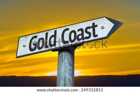 Gold Coast sign with a sunset background - stock photo
