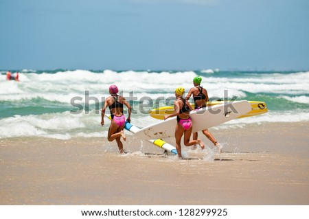 GOLD COAST, SURFERS PARADISE, QLD,  AUSTRALIA - FEB 9. 2013: J. Mercer (3) T. Coleman (16) compete on the round four of the Surf Ironwoman Series on February 09th 2013, Gold Coast Australia. - stock photo
