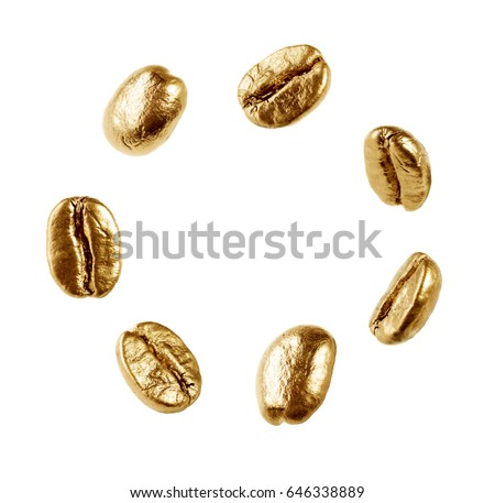 Gold coffee beans isolated on white background
