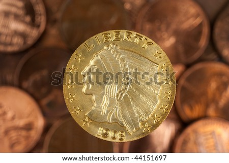 Gold coin and pennies
