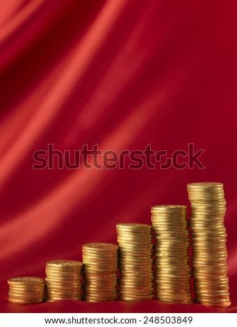 gold coin arranged form a graph  - stock photo