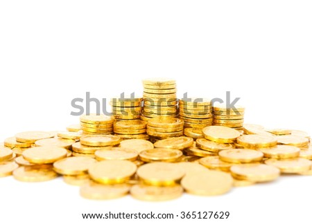 Gold coin from chocolate sweet on white background