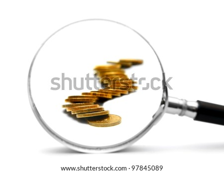 Gold coins and magnifier. On a white background. - stock photo