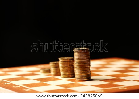 Gold coins and money is not a table, finances and growth concept on black background - stock photo