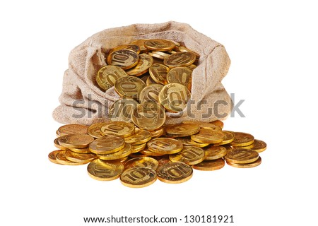 Gold coins fall out of a canvas bag on white background - stock photo