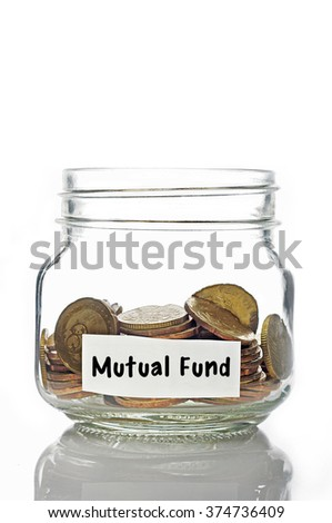 Gold coins in jar with Mutual Fund label isolated in white background - stock photo