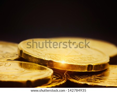 Gold coins macro on black - stock photo