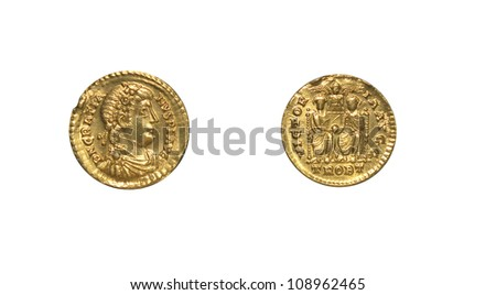 gold coins, minted during the reign of the emperor Gratian around 360 AD.  Isolated against a white background - stock photo