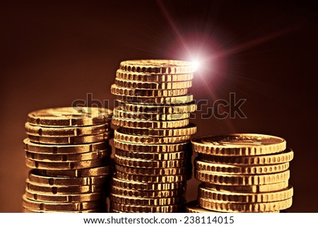 Gold coins on black background. Selective focus. - stock photo