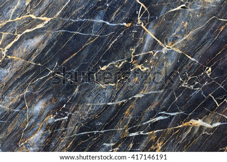 Gold color pattern of dark marble pattern for background and design. - stock photo