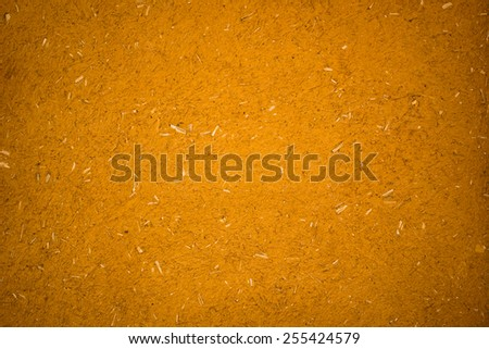 Gold color texture of soil on the wall background - stock photo