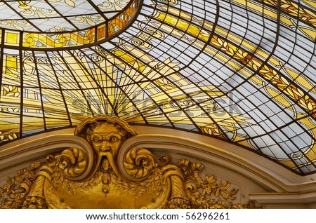 Gold colored stained glass windows as part of a domed cieling