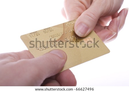 Gold coloured credit card being passed over. Branding and number removed for security. - stock photo