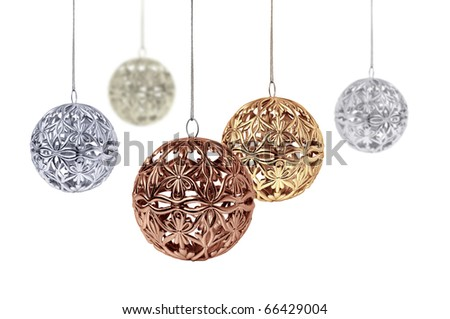 Gold copper silver Christmas balls hanging on white background - stock photo