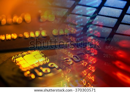 Gold credit card and digital data. Macro image - stock photo