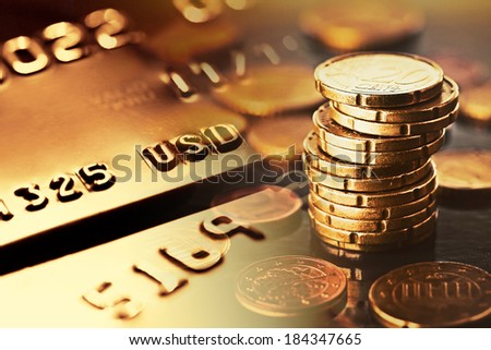 Gold credit card and euro coins.