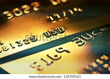 Gold credit card. Macro image - stock photo