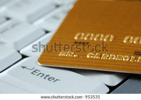 Gold Credit Card on a Keyboard. Close-up. - stock photo