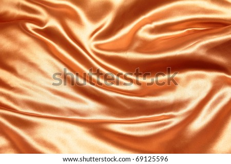 gold crumpled silk fabric textured background - stock photo