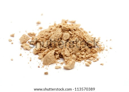 gold crushed eyeshadow isolated on white background - stock photo