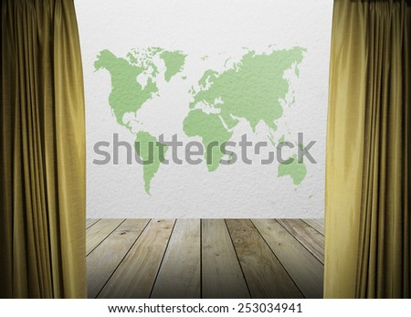 gold curtains on white wall texture and green map of the world with wooden paving. - stock photo