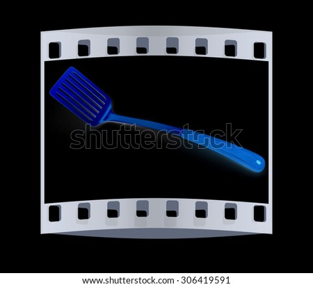 gold cutlery on blsck background. The film strip - stock photo