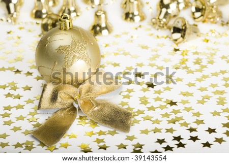 Gold decoration Christmas Ball and stars, handbells, bow.