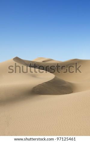 Gold desert at sea beach. Sunny day. Canary Islands, Canaries. Grand Canary. Maspalomas, Resort Town. - stock photo