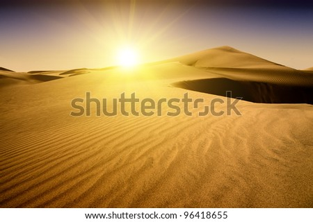 Gold desert into the sunset. Canary Islands, Canaries. Grand Canary. Maspalomas, Resort Town.