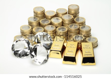 Gold, diamonds and euro coins lying on a pile. - stock photo
