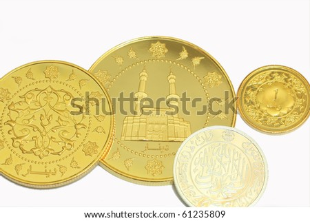 gold dinar and siver dirham on white background - stock photo