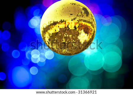 Gold disco ball with colored lights - stock photo