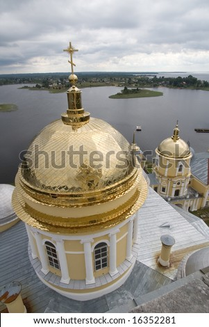 Gold domes of orthodox church in a monastery of Nil Stolbenskij,  lake Seliger, near Ostashkov, Russia, view from a belltower (1)