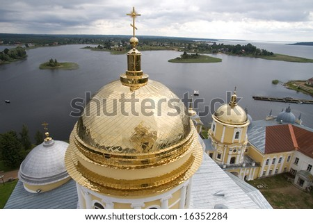 Gold domes of orthodox church in a monastery of Nil Stolbenskij lake Seliger, near Ostashkov, Russia, view from a belltower (2)