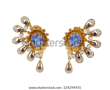 gold earrings isolated on white - stock photo