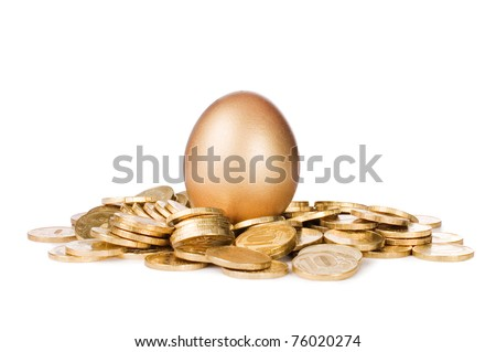 Gold egg in golden coins isolated on white - stock photo