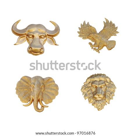 Gold emblem of animal mask, isolated against white. - stock photo