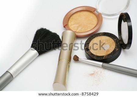 Gold eyeshadows and brushes - stock photo