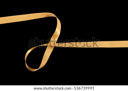 gold fabric ribbon on black background
