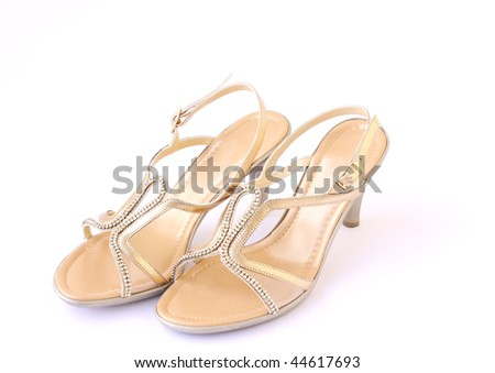 gold female buckle up sandles isolated on a white background - stock photo