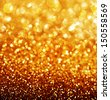 Gold Festive Background. Abstract Golden Christmas and New Year Bokeh blinking background with copyspace - stock photo