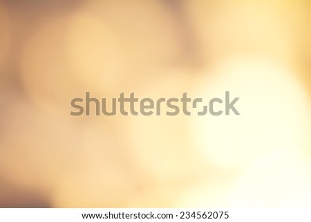 Gold Festive Christmas background. Abstract twinkled bright background with natural bokeh defocused golden lights. Holiday party background with blurry special magic effect.  - stock photo