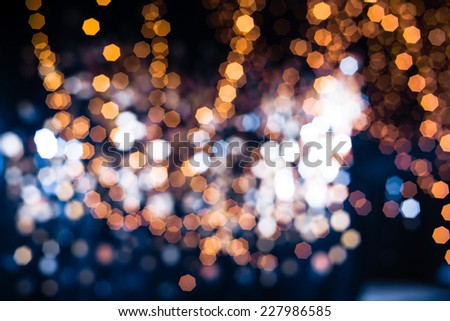 Gold Festive Christmas background. Golden Abstract Backdrop with Lights and Stars. Bokeh - stock photo