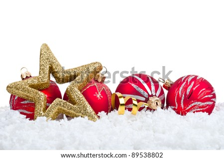 Gold five pointed star and red ball christmas decoration on snowflakes background - stock photo