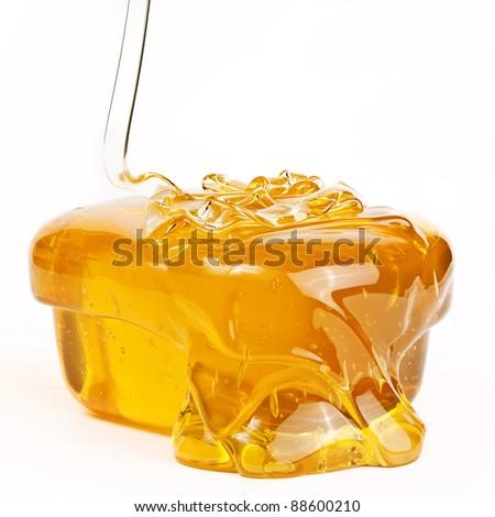 Gold flowing honey isolated on white background - stock photo