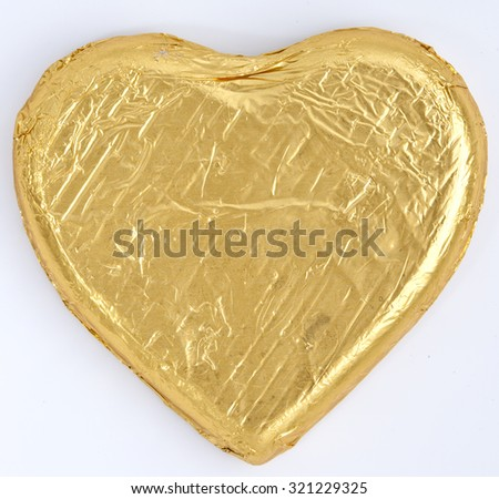 Gold Foil wrapped heart chocolates - stock photo