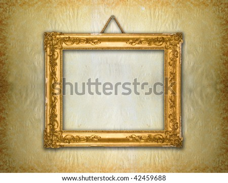 Gold frame, aged wallpaper - stock photo